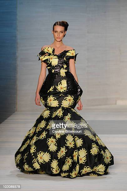 A model displays a design by Andre Lima during the sixth day of the Sao Paulo Fashion Week Summer 2011 at Bienal pavilion on June 14 2010 in Sao...
