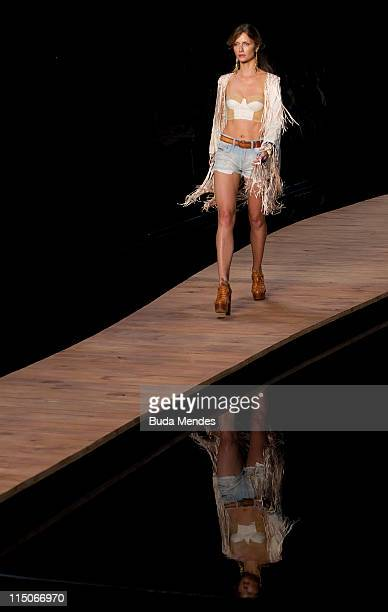 A model displays a design by Coca Cola Clothing during the Fashion Rio Summer 2012 at Pier Maua on June 02 2012 in Rio de Janeiro Brazil