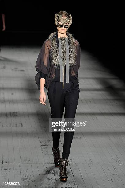 Model displays a design by Huis Clos during the fourth day of Sao Paulo Fashion Week Fall 2011 at Ibirapuera's Bienal Pavilion on January 31 2011 in...