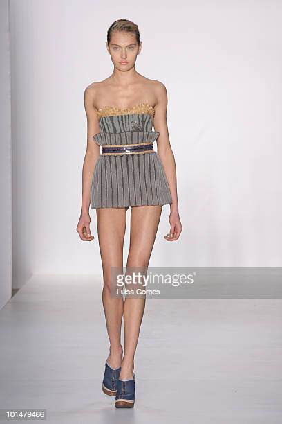 Model displays a design by Lucas Nascimento during the sixth day of Fashion Rio Summer 2011 at Pier Maua on June 01, 2010 in Rio de Janeiro, Brazil.
