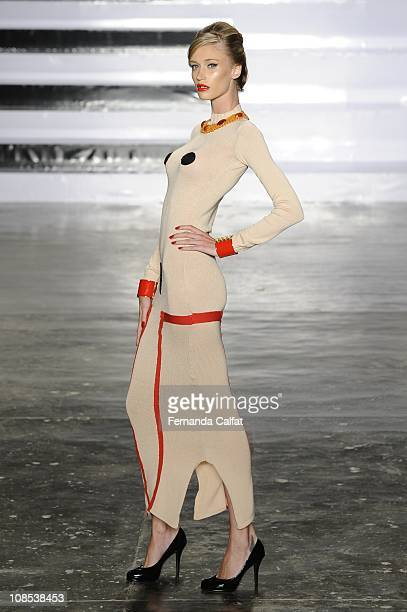 Model displays a design by Neon during the Second day of Sao Paulo Fashion Week Fall 2011 at Ibirapuera's Bienal Pavilion on January 29 2011 in Sao...