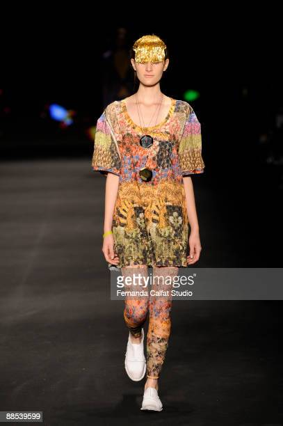 A model displays a design by Osklen during the first day of the Sao Paulo Fashion Week SpringSummer 2010 collection at the Bienal Pavilion in...