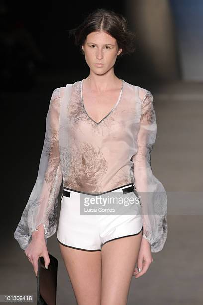 A model displays a design by Patachou during the fifth day of Fashion Rio Summer 2011 at Pier Maua on May 31 2010 in Rio de Janeiro Brazil