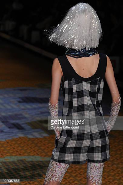 A model displays a design by Ronaldo Fraga during the sixth day of the Sao Paulo Fashion Week Summer 2011 at Bienal pavilion on June 14 2010 in Sao...