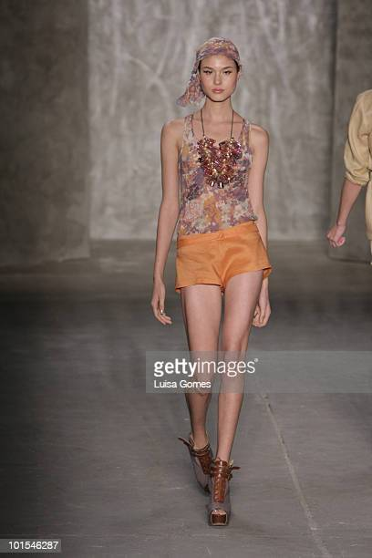 A model displays a design by Teca during the sixth day of Fashion Rio Summer 2011 at Pier Maua on June 1 2010 in Rio de Janeiro Brazil