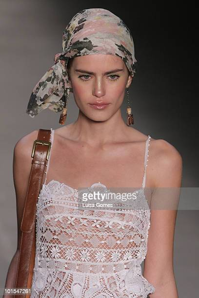 A model displays a design by Teca during the sixth day of Fashion Rio Summer 2011 at Pier Maua on June 01 2010 in Rio de Janeiro Brazil