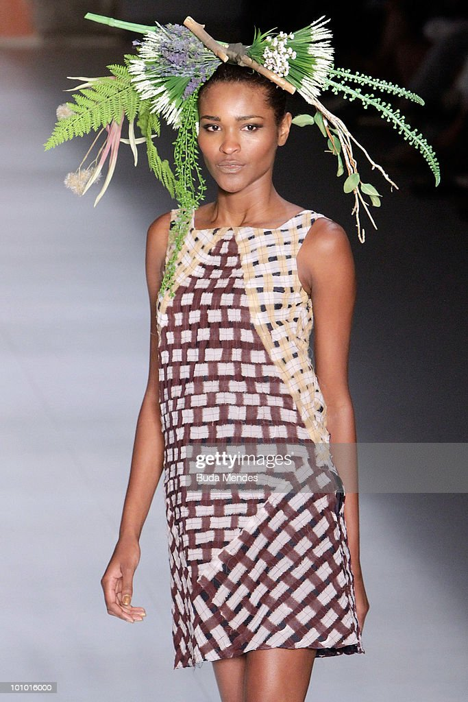 A model displays a design by Walter Rodrigues during the first day of Fashion Rio Summer 2011 at Pier Maua on May 27, 2010 in Rio de Janeiro, Brazil.