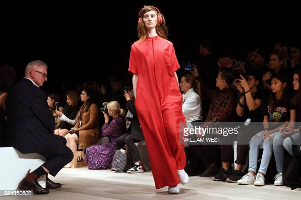 A model displays a design from the Australian label Akira during Fashion Week Australia in Sydney on May 18 2017 / AFP PHOTO / William WEST