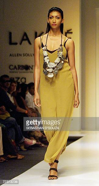Model displays a design from the collection by designer Savio Jon on the fourth day of the ongoing Lakme Fashion Week at the National Center for...