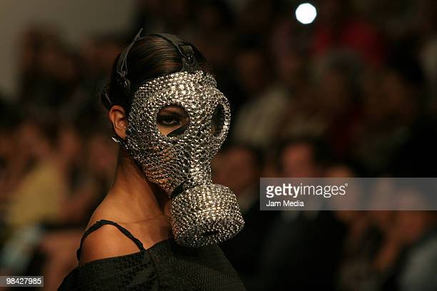 A model displays a design of Gianfranco Reni during the Mercedes Benz Fashion Week 2010 at Campo Marte on April 12 2010 in Mexico City Mexico...