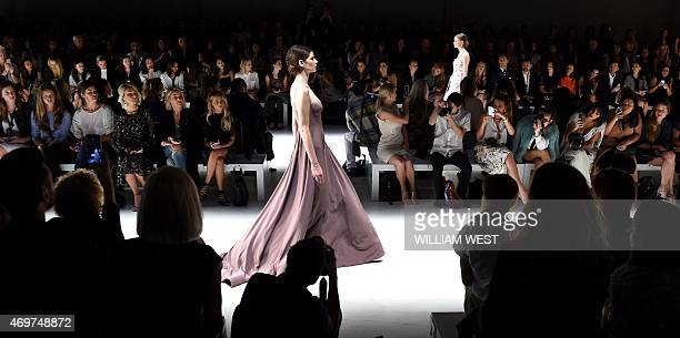 A model displays a dress by Australian designer Steven Khalil during a parade of his garments at Fashion Week Australia in Sydney on April 15 2015...