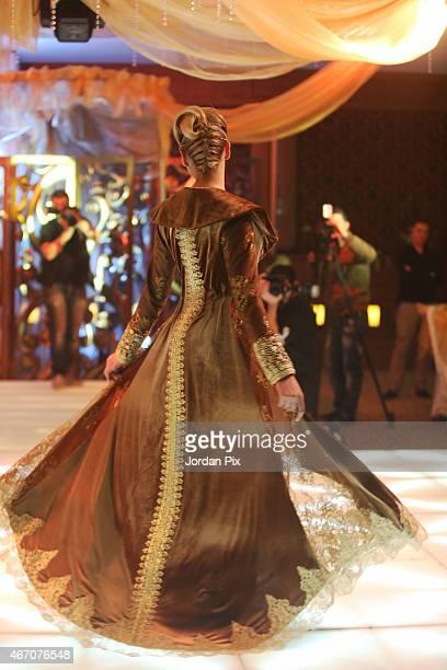A model displays a dress by Jordanian designer Ayat Al Zoubi in her annual Abaya fashion show March 20 2015 in Amman Jordan
