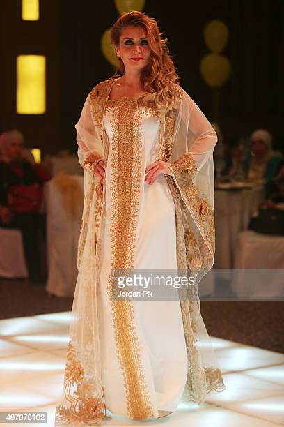 A model displays a dress by Jordanian designer Ayat Al Zoubi in her annual Abaya fashion show March 20 2015 in Amman Jordan