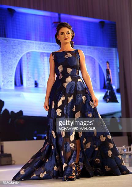 A model displays a dress created by Omani designer Sahar alAufi during the Omani Women's Fashion Trends event in the Omani capital Muscat on August...