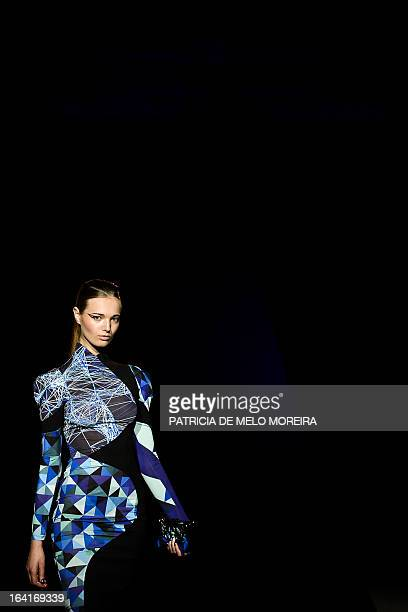 Model displays a Fall/Winter 2013-2014 creation by Portuguese fashion designer Fatima Lopes during the 32nd Portugal Fashion at the Convento do Beato...