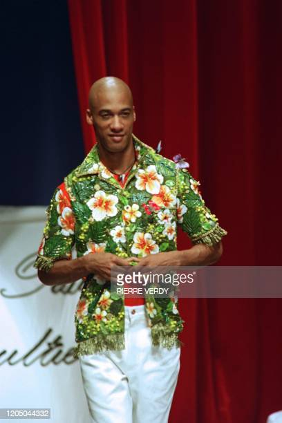Model displays a flowerfull shirt of French designer Jean-Paul Gaultier, on July 3, 1992 during the show of the Spring/Summer 93 ready-to-wear...