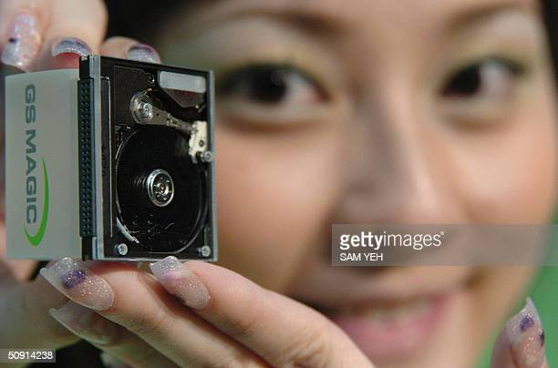 Model displays a latest 4.4 GB MagicStor CF card, about 220 US dollar each on the market, during the 2004 Computex Taipei at the World Trade Center...