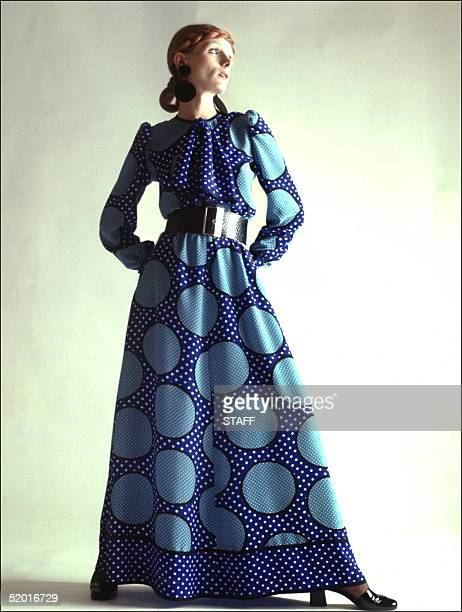 A model displays a long blue spotted dress wide belt and blue and white doted scarf 04 February 1970 in Paris for Christian Dior 1970 Spring/Summer...