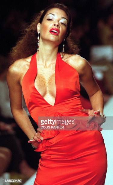 A model displays a red dress with side drapes at the Manuel Fernandez show during Spring 2001 Fashion in New York 16 September 2000 AFP PHOTO Doug...