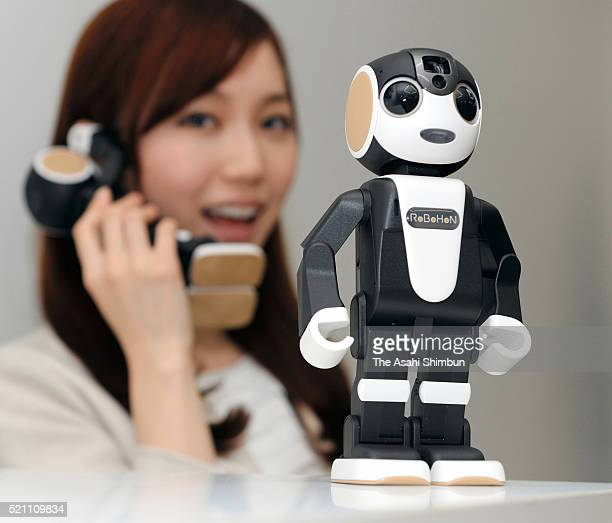 A model displays a robotshaped mobile phone 'RoBoHon' during a press conference on April 14 2016 in Tokyo Japan Designed by robot creator Tomotaka...