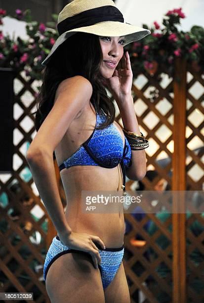 A model displays a Sanai creation during the company's 2014 swimwear collection presentation in Tokyo on September 14 2013 Sanai presented 17 sets...