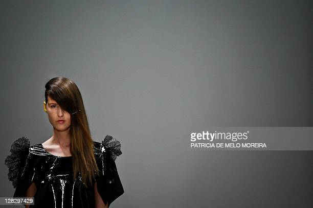 Model displays a Spring/Summer 2012 creation by Portuguese fashion designer Alexandra Moura during the 37th Edition of Moda Lisboa at Patio da Gale,...
