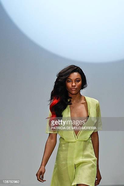 Model displays a Spring/Summer 2012 creation by Portuguese fashion designer Ricardo Preto during the 37th Moda Lisboa at Patio da Gale, Terreiro do...