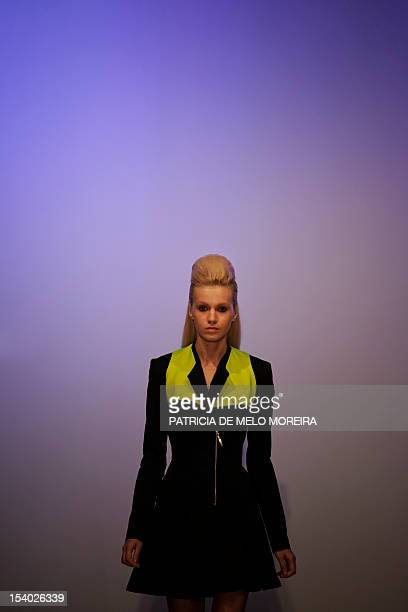 """Model displays a Spring/Summer 2013 creation by Portuguese fashion duo designers """"Os Burgueses"""" during the 39th Edition of Moda Lisboa at Patio da..."""