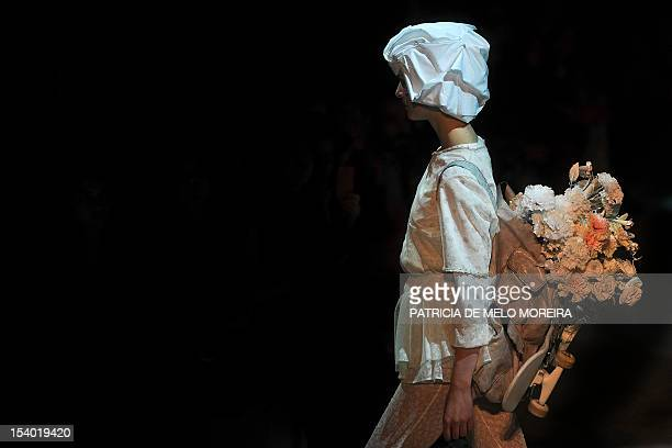 A model displays a Spring/Summer 2013 creation by Portuguese fashion designer Alexandra Moura during the 39th Edition of Moda Lisboa at Patio da Gale...