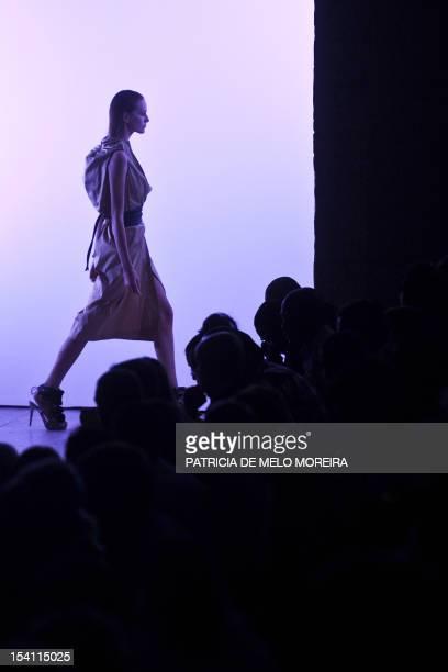 A model displays a Spring/Summer 2013 creation by Serbian fashion designer Aleksandar Protic during the 39th Edition of Moda Lisboa at Patio da Gale...
