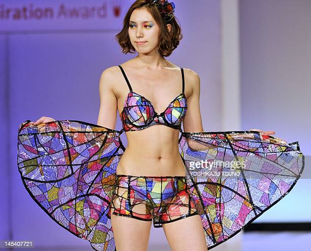 A model displays a stained glass motif underwear designed by Hiroko Kanekawa a student of Japan's Bunka Fashion College during a lingerie design...