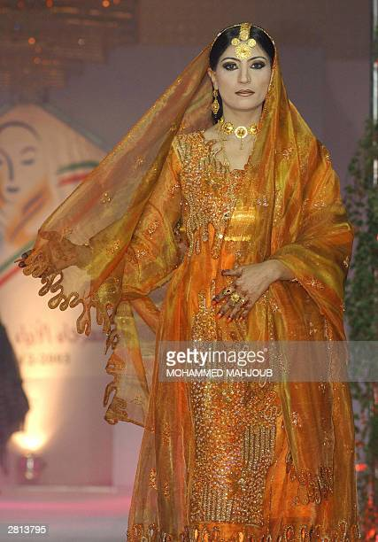 A model displays a traditional costume from the Muscat governorate during a fashion show organized by the Omani Women's Association in the capital...