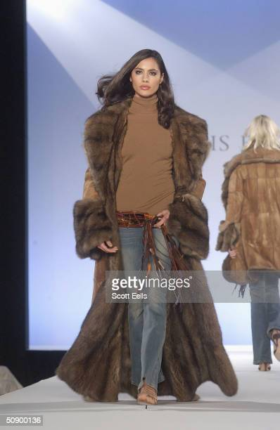 A model displays a walks the catwalk at the Dennis Basso Fall/Winter Fashion Show on May 26 2004 in New York City Basso writes that the collection...