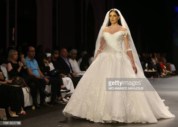 A model displays a wedding dress created by Omani designer Malak alMusafir during the launch of the 6th edition of the Ladies A La Mode fashion show...