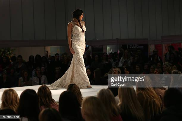 A model displays a wedding dress design at the London Wedding Show at ExCel on January 30 2016 in London England The show advertises numerous...