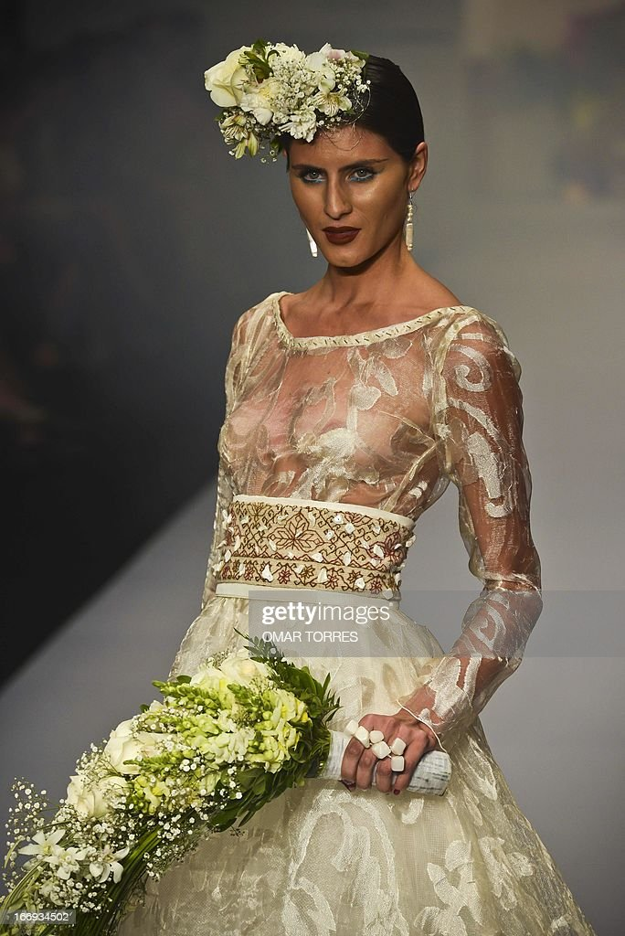 A Model Displays Wedding Dress Of Mexican Designer Lydia Lavin During The Autumn Winter