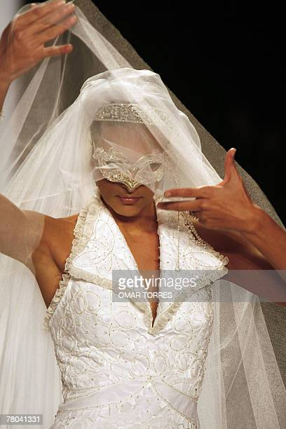 A model displays a wedding dress Peruvian designer Claudia Jimenez during the first day of Fashionweek in Mexico City 23 October 2007 AFP PHOTO/Omar...