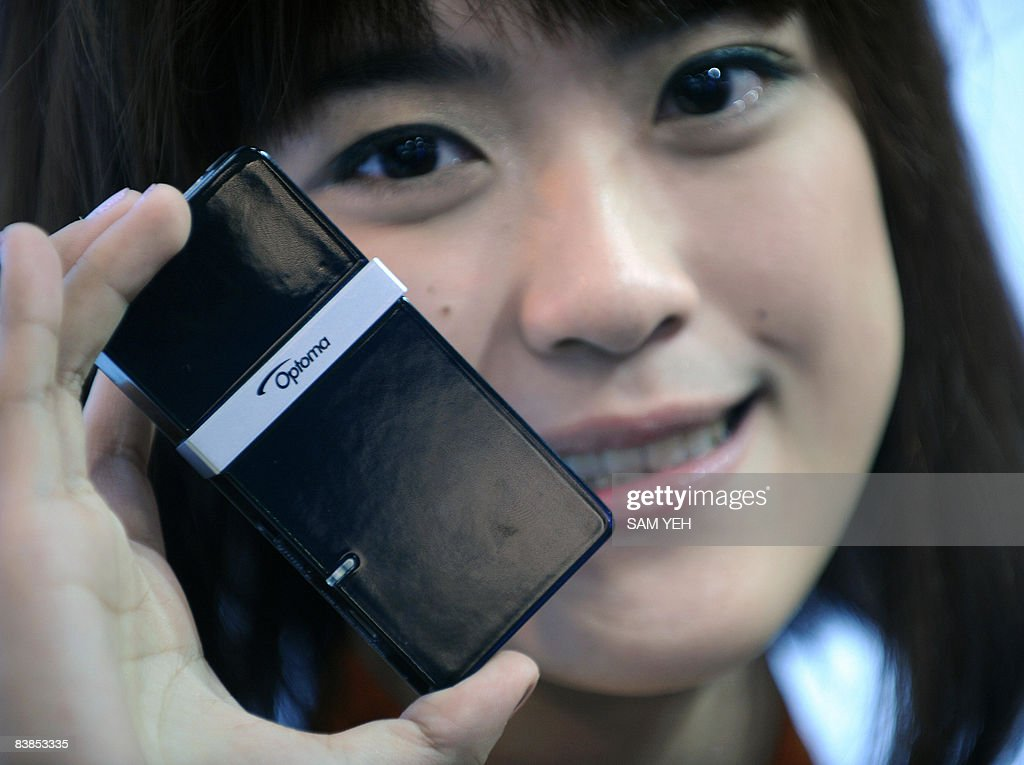 A model displays a world smallest projector Optoma PK101