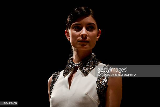 Model displays an Autum/Winter 2013/2014 creation by Portuguese fashion designer Miguel Vieira during the 40th Edition of Moda Lisboa at Patio da...