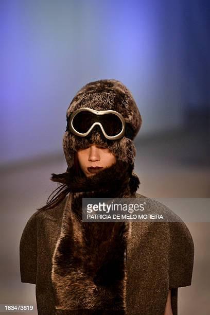 Model displays an Autum/Winter 2013/2014 creation by Portuguese fashion designer Filipe Faisca during the 40th Edition of Moda Lisboa at Patio da...