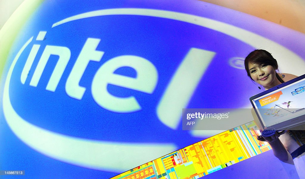 A model displays an Intel Ultrabook using a third generation Intel core processor at 2012 Computex in Taipei on June 7, 2012. Computex is Asia's leading IT trade fair. AFP PHOTO / Mandy CHENG