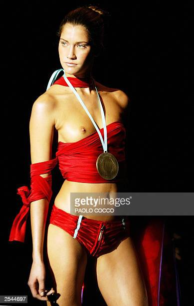 A model displays an outfit by Colombian designer Silvia Tcherassi during Milan's 2004 Spring/Summer fashion week 29 September 2003 The Milan fashion...