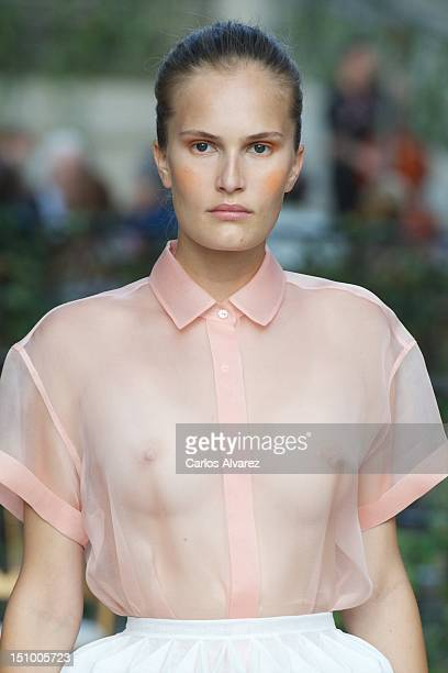 A model displays an outfit by DelPozo during the MercedesBenz Fashion Week Madrid Spring/Summer 2013 at El Capricho Park on August 30 2012 in Madrid...