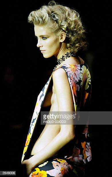 A model displays an outfit by Fisico shown during the Milan's 2004 Spring/Summer fashion week 30 September 2003 The Milan fashion week will run until...