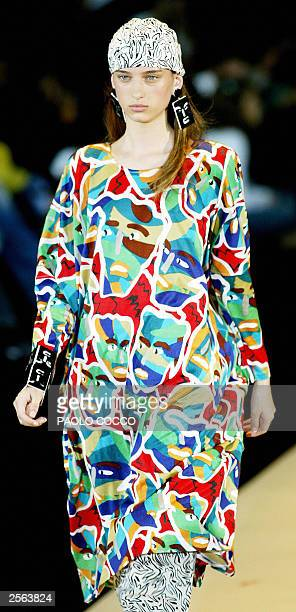 A model displays an outfit by Missoni collection during the last day of Milan's 2004 Spring/Summer fashion week 05 October 2003 AFP PHOTO/PAOLO COCCO