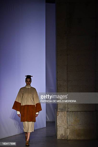 A model displays an outfit by Portuguese designer Alexandra Moura of the Autumn/Winter 20132014 collection during the 40th edition of the Moda Lisboa...