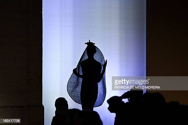 Model displays an outfit by Portuguese designer Alexandra Moura of the Autumn/Winter 2013-2014 collection during the 40th edition of the Moda Lisboa...