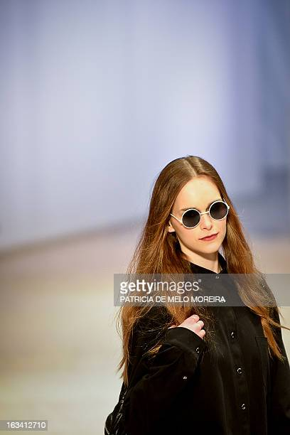 """Model displays an outfit by Portuguese duo designers """"Os Burgueses"""" of the Autumn/Winter 2013-2014 collection during the 40th edition of the Moda..."""