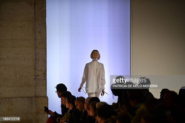 A model displays an outfit by Serbian fashion designer Aleksandar Protic of the Autumn/Winter 20132014 collection during the 40th edition of the Moda...