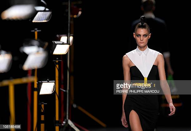 A model displays an outfit by Spanish designer David Delfin during the Madrid Cibeles Fashion week in Madrid on September 22 2010 AFP PHOTO /...